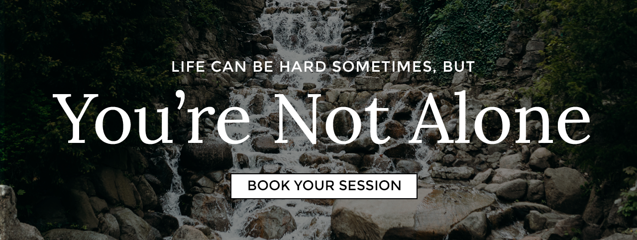 """Life can be hard sometimes, but you're not alone."" Click here to book your session. Waterfall in the background."